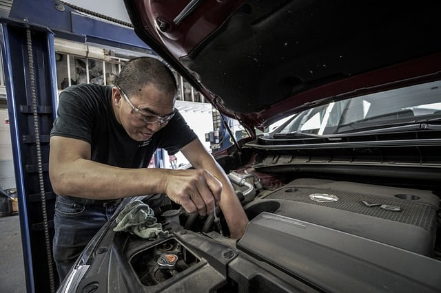 Mechanic repairing a car engine