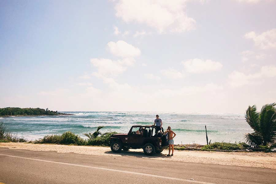 Jeep on a road trip by the beach in summer